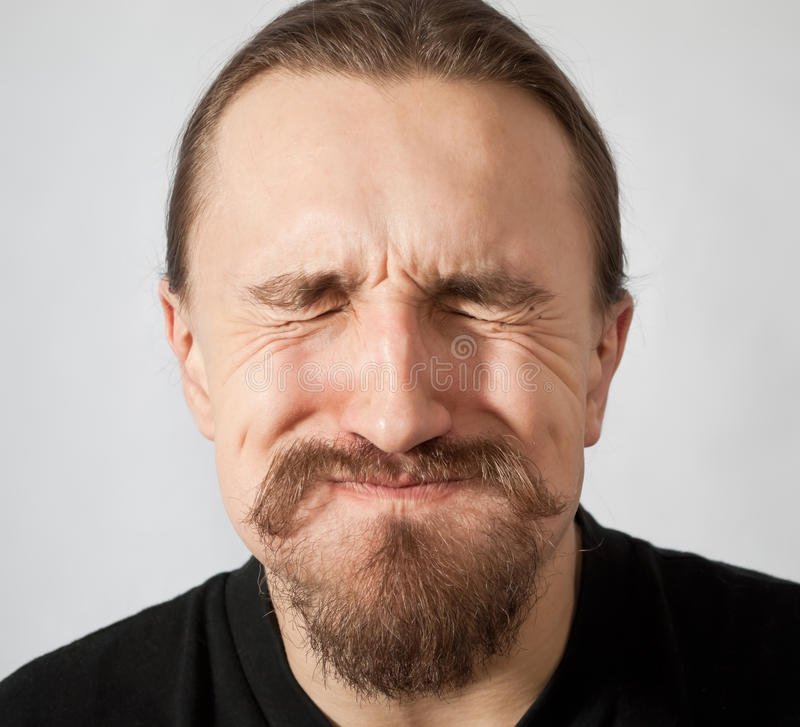 Constipation. Puffed up man with eyes closed tightly stock photos