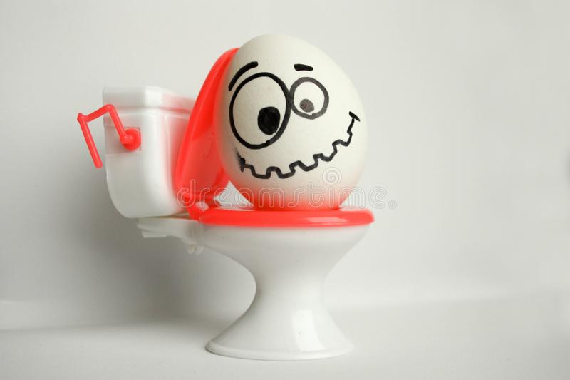 Constipation is a comical concept. an egg stock image