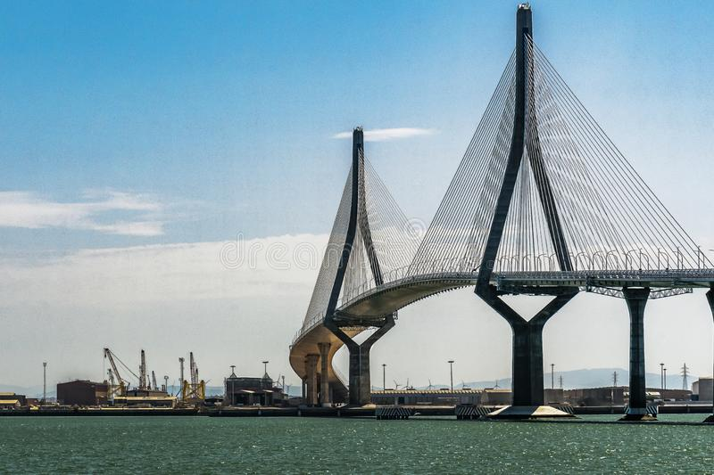 Bridge of the Constitution of 1812. Cadiz, Spain. The Constitution Bridge of 18125 originally called Pepa Bridge is a cable-stayed bridge that crosses the Bay of stock photography