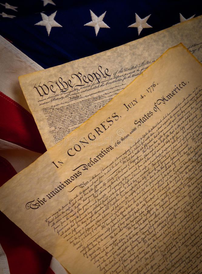 Constitution and Declaration on a flag. A copy of the constitution and the declaration of indepenedence of the United States on a flag background stock image