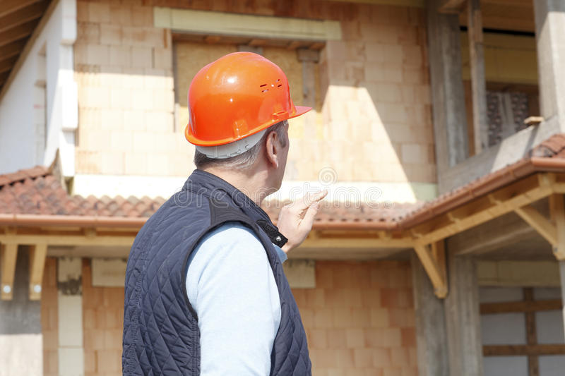 Constraction architect. Construction architect working at constraction site stock photography