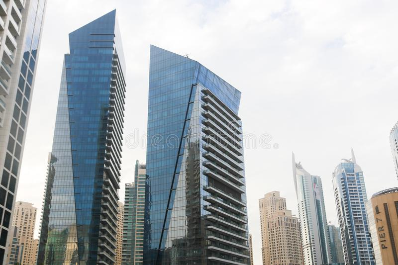 Constraction. Modern towers with clear reflections, Dubai, United Arab Emirates royalty free stock photography