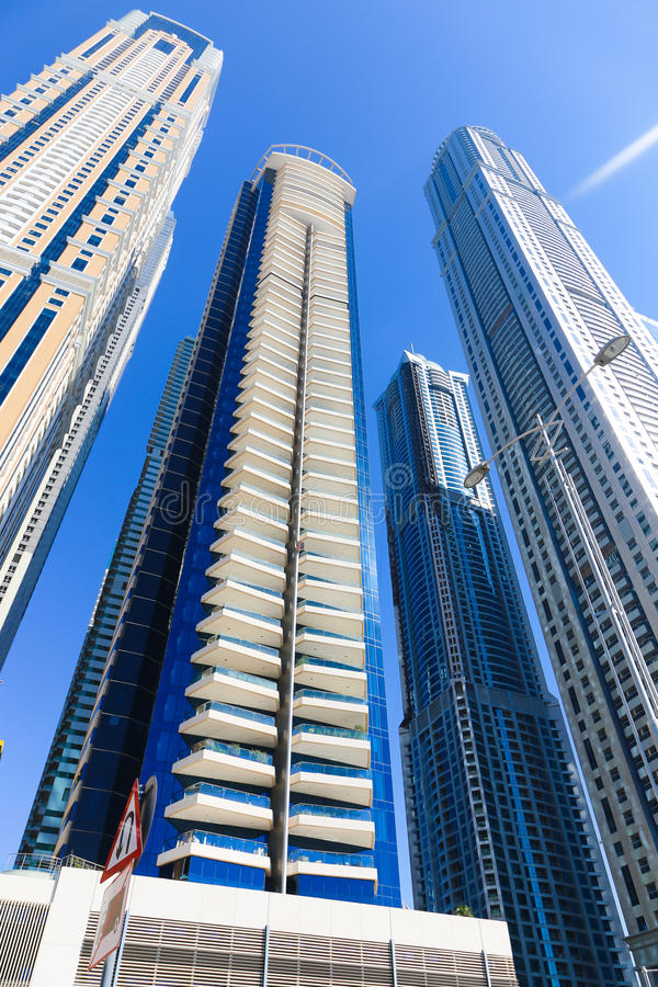 Constraction. Modern towers with clear reflections, Dubai, United Arab Emirates royalty free stock image