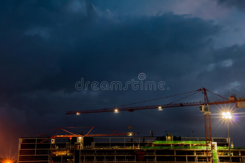 Constraction site with a crane at night. Night sky background royalty free stock image