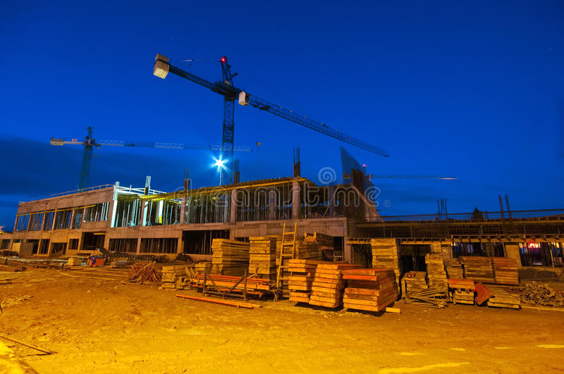 Constraction site at night. Constraction site with a crane at night stock images