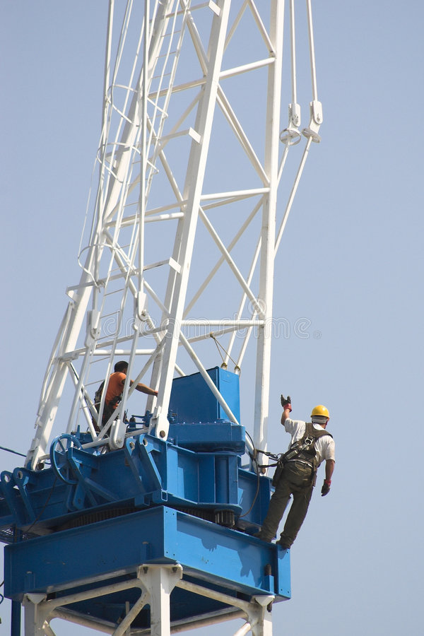Constrction worker on crane stock photography