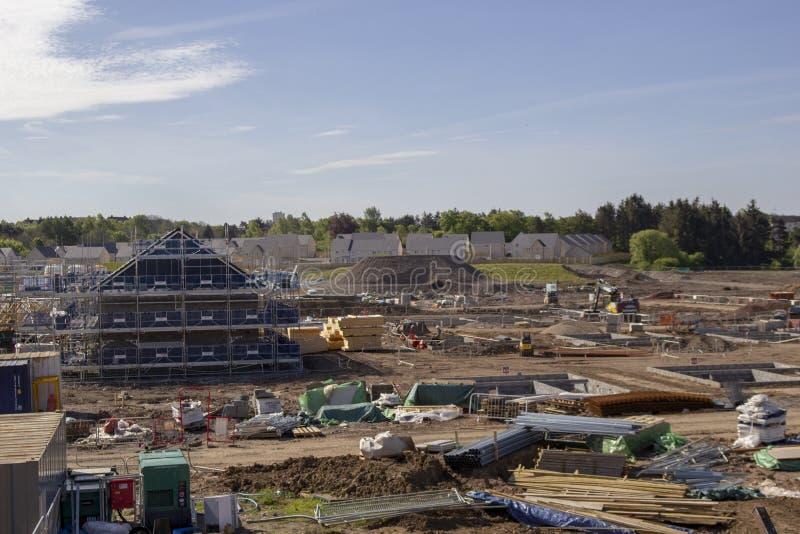 Construção de casa no local velho de Rolls royce em do leste - kilbride imagem de stock royalty free