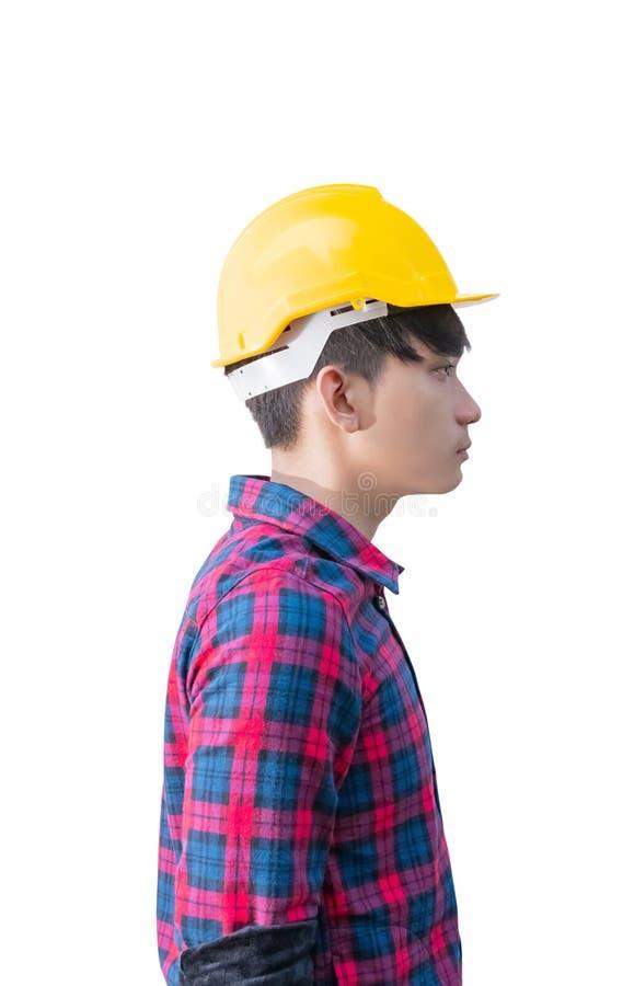 Construção do coordenador da vista lateral e para vestir o plástico amarelo do capacete de segurança no fundo branco imagem de stock