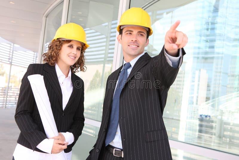 Construção do homem e da mulher fotos de stock royalty free