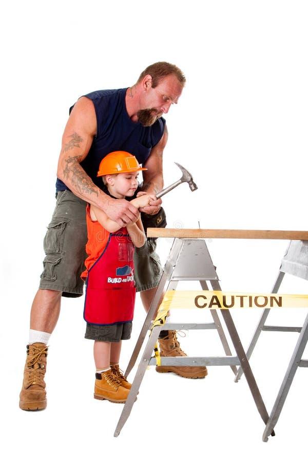 Construcción de enseñanza del hijo del padre fotos de archivo