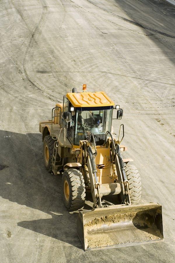 Construcción de la autopista sin peaje; niveladora imagen de archivo
