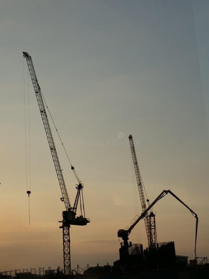 Construcción de la puesta del sol foto de archivo
