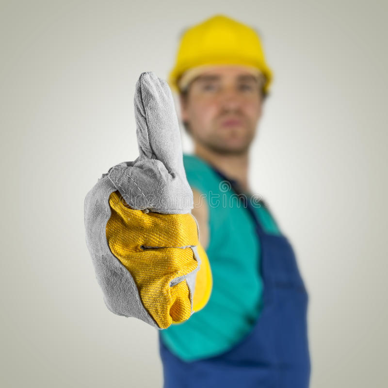 Construcion worker showing thumbs up sign stock photos