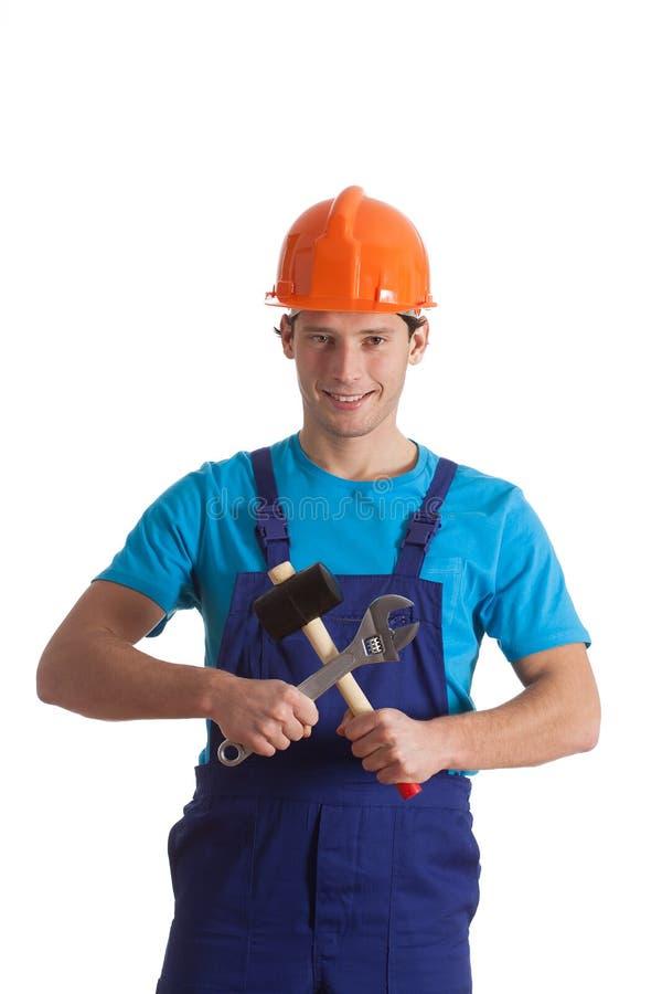Constructeur avec le marteau et la clé photographie stock
