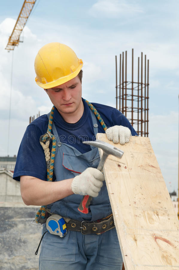 Constructeur fonctionnant avec le marteau photo libre de droits