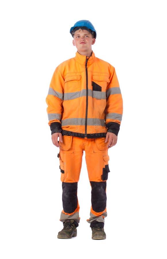 Constructeur pensif dans des vêtements de fonctionnement photos libres de droits