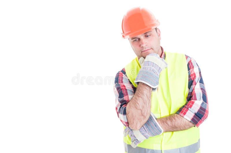 Constructeur réfléchi se reflétant à quelque chose photo stock