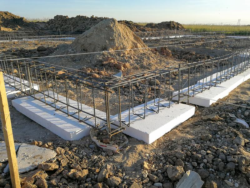 New house foundation under consruction. Constructing new foundation for house. First stage of building the house royalty free stock photo