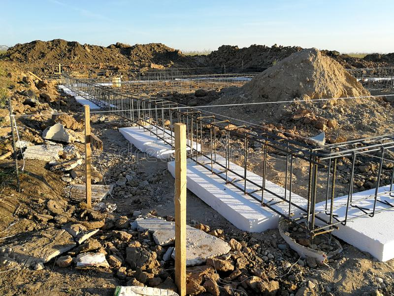 New house foundation under consruction. Constructing new foundation for house. First stage of building the house royalty free stock images
