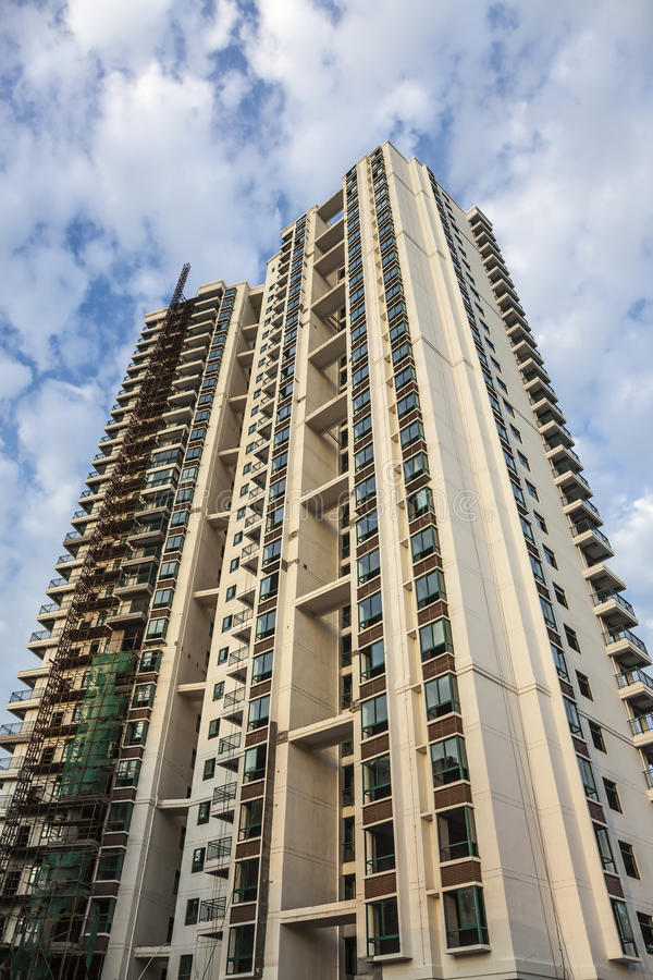 Constructing tall apartment building royalty free stock photos