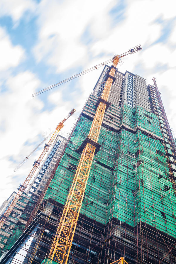 Constructing tall apartment building royalty free stock photo