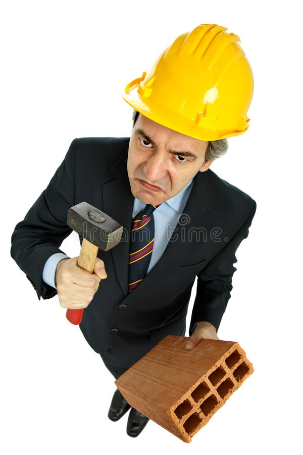 Construction. Engineer holding a hammer and a brick, isolated on white stock images