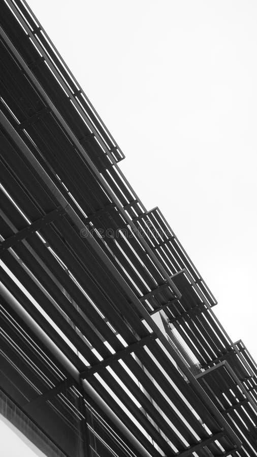 Construction abstract composition metal shutter on the facade vertical stock photos