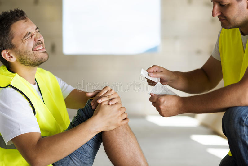 Construction accident. Construction worker has an accident while working on new house royalty free stock photo