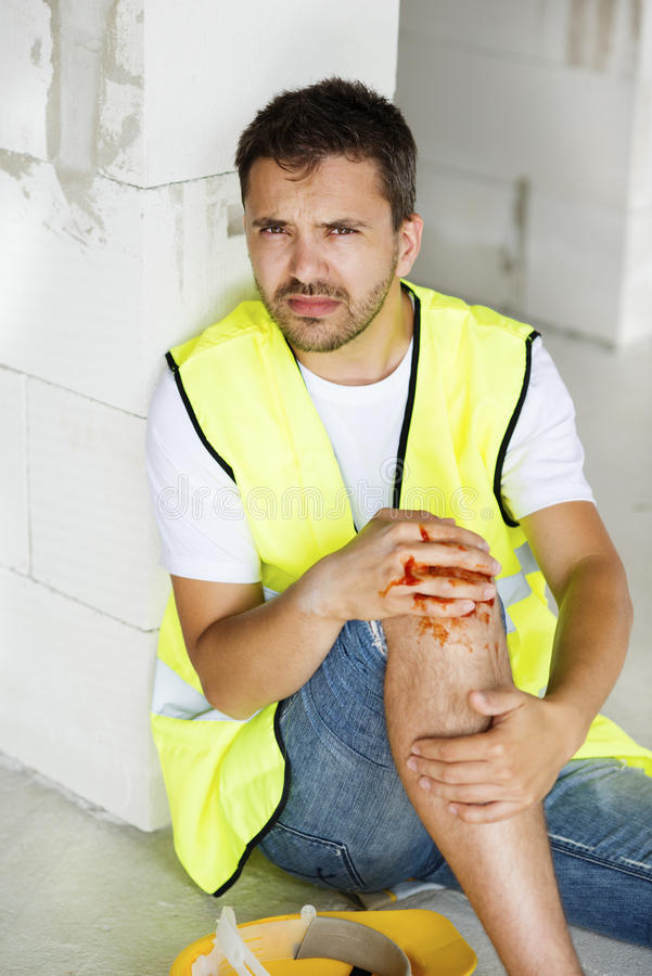 Construction accident. Construction worker has an accident while working on new house royalty free stock photography