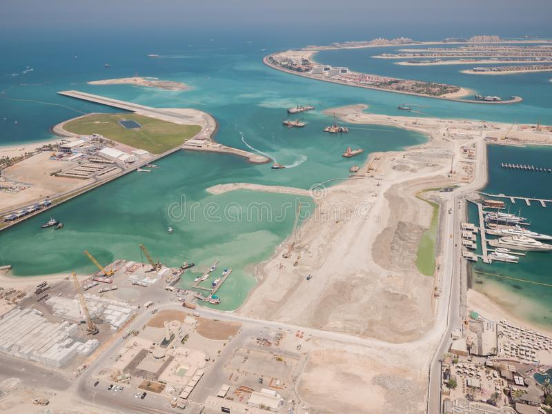 Construction of an artificial island Palm Jumeirah with construction equipment in Dubai. stock image