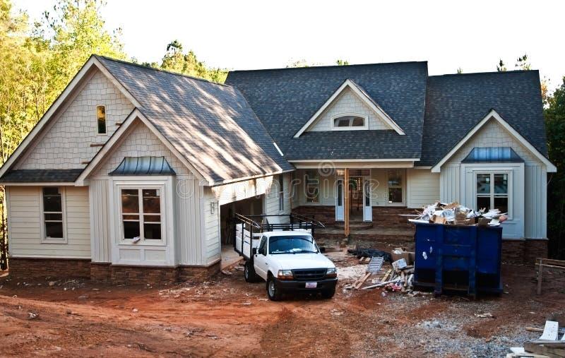 Construction/avant à la maison neufs photographie stock