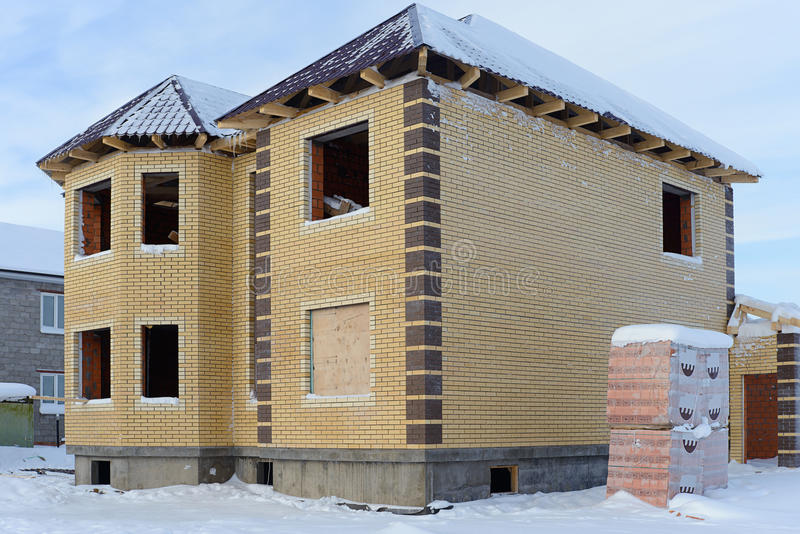 Construction of a brick home in winter royalty free stock photos