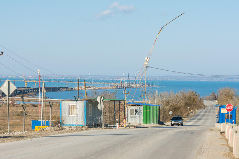 Construction of a bridge across the Kerch Strait, the control checkpoint on the road leading to stock photo