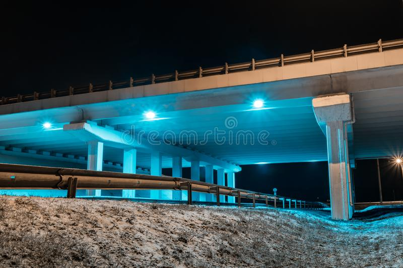 Construction bridge light blue transportation night architecture. Winter night road royalty free stock images