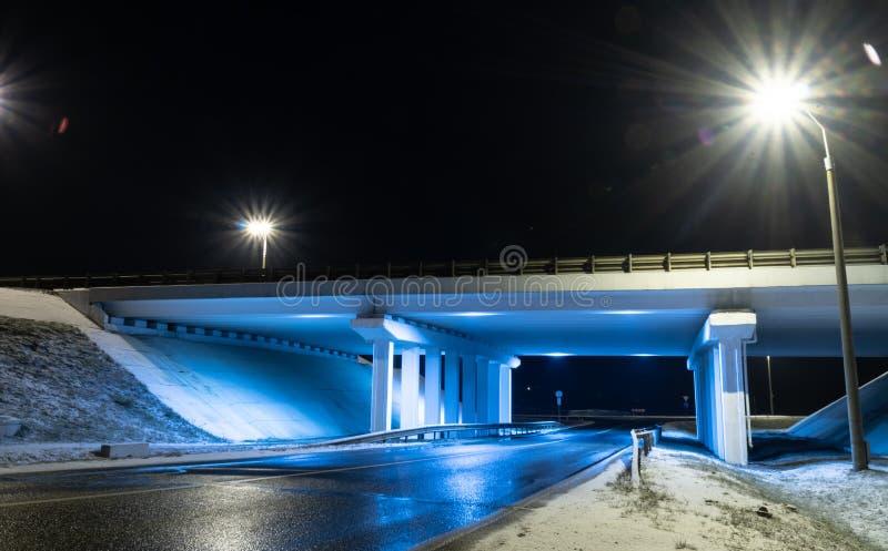 Construction bridge light blue transportation night architecture. Winter night road stock photos