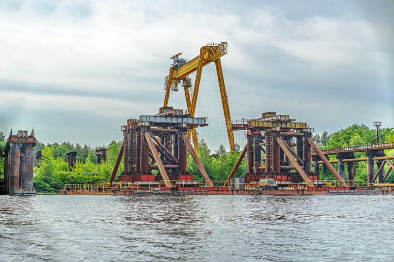 Construction of a bridge over the river. Temporary construct. Construction of a bridge over the river. Temporary metal construct royalty free stock images