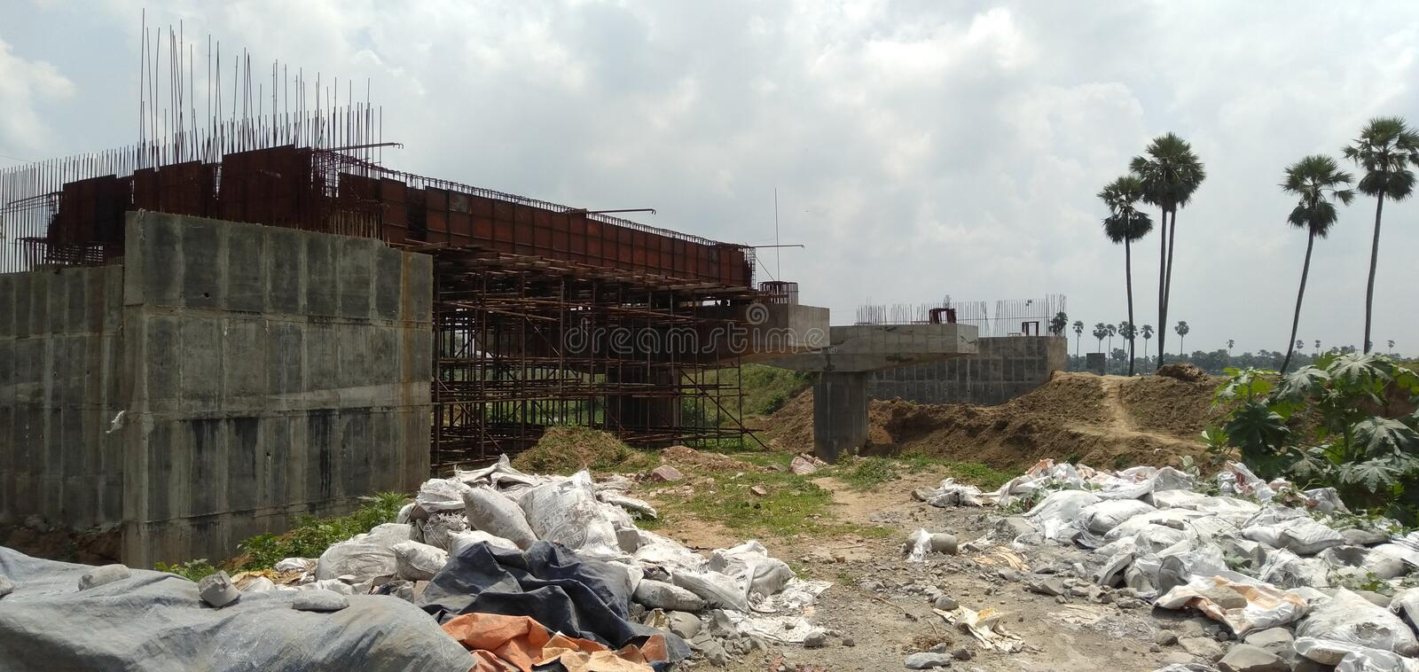 Construction of Bridge is underway in Biharsharif, India. This Photo is under construction fo a bridge in biharsharif. India. This is the scene of a village stock images