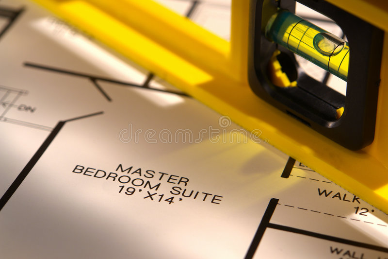 Construction Bubble Spirit Level And House Plan Royalty Free Stock Photo