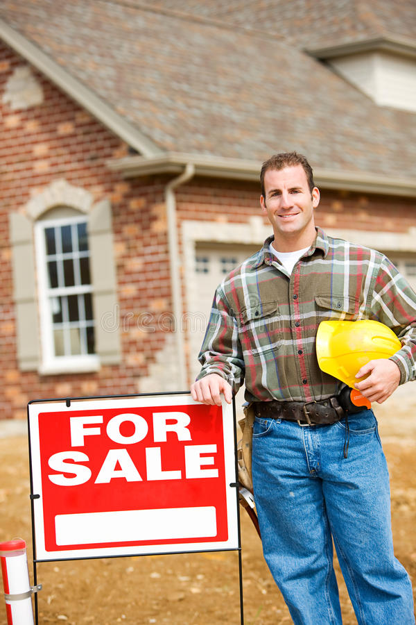 Construction: Builder Stands By Sale Sign stock image