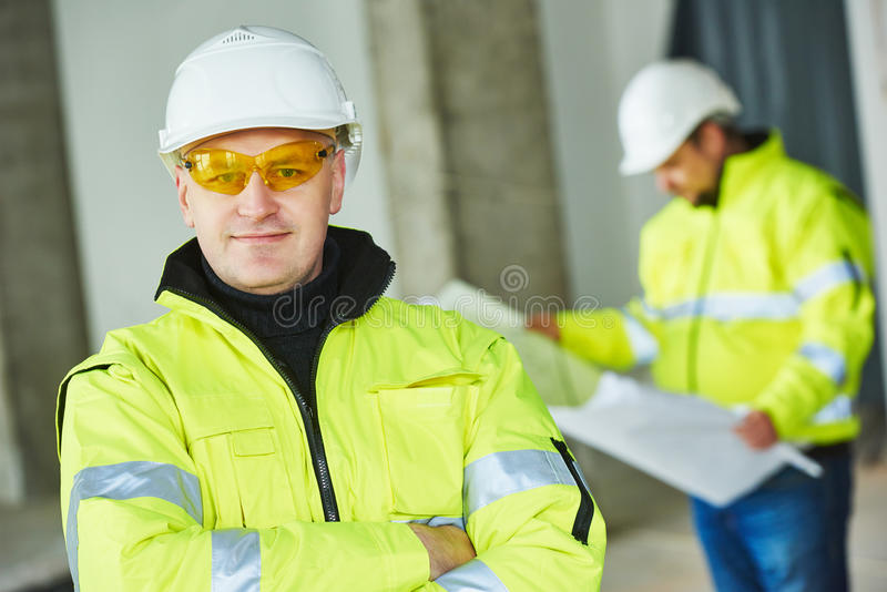 Construction builder worker at site. Young male construction engeneer worker project manager at a indoors building site royalty free stock photos