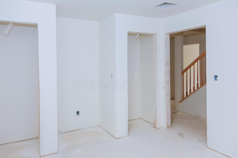 Construction building industry new home construction Building construction gypsum plaster walls. Construction building industry new home construction interior stock photo