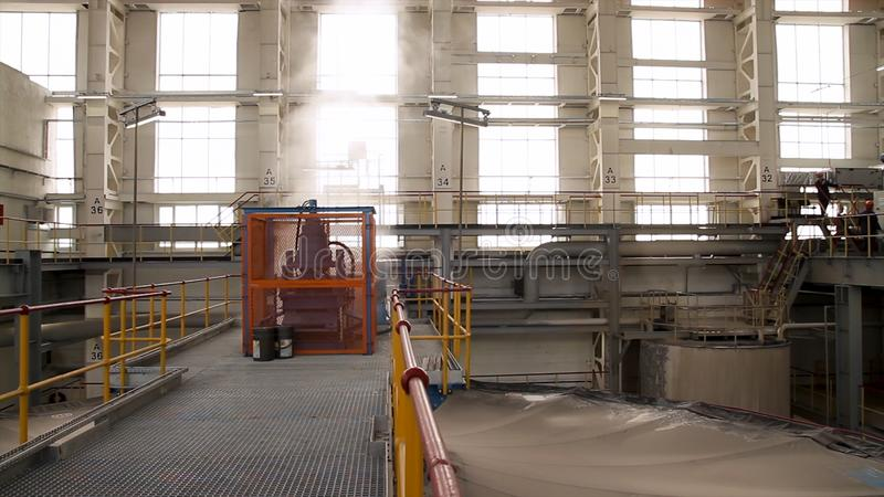 Construction of building interior of factory. Modern industrial building. Equipment and piping as found inside of stock photography
