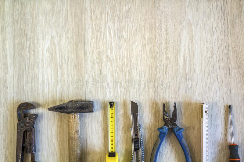 Construction, building and repair tools set for house work on wooden background. Top view. royalty free stock photos