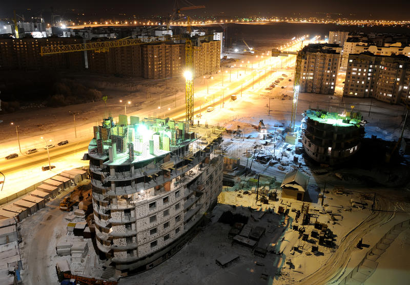 Construction building site at night royalty free stock photography