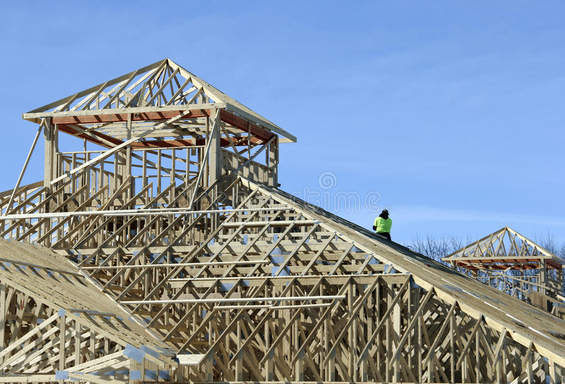 Construction of a building. Construction worker on the structure of a building project stock photography