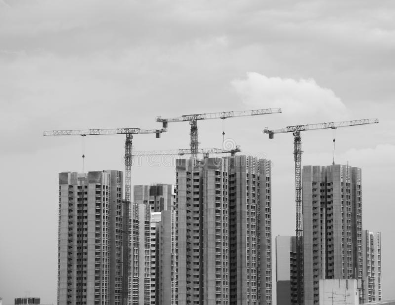 Tall buildings construction site. Buildings construction process with cranes, construction industry royalty free stock photos