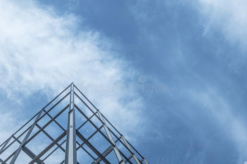 The construction of buildings with steel structure on sky background stock image