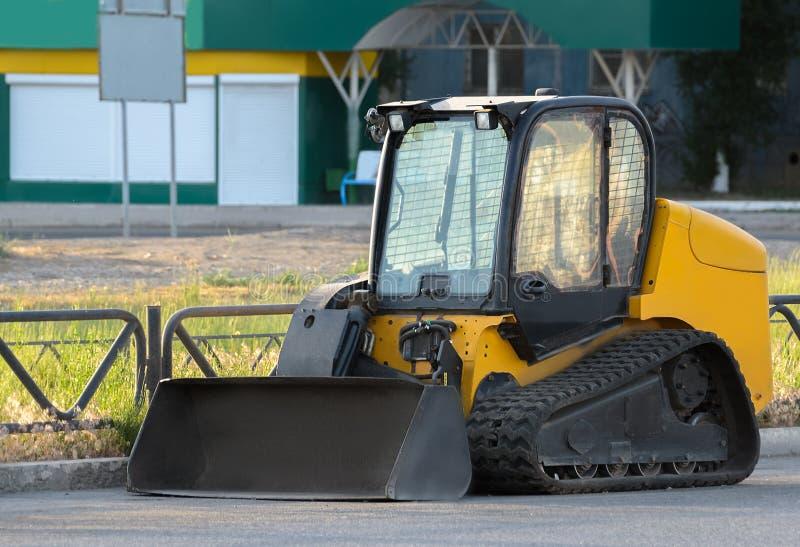 Construction Bulldozer Tractor Excavator. On city street stock images