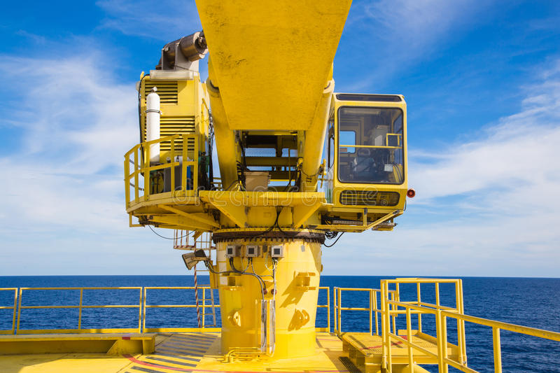 Construction cane at oil and gas well head remote platform. royalty free stock photos