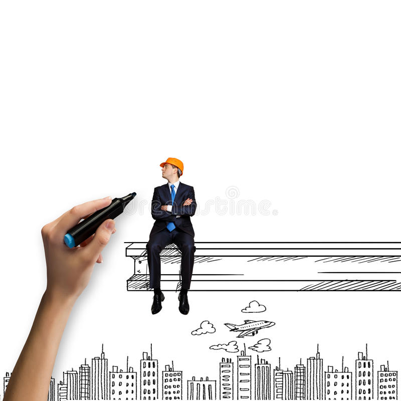 Construction concept. Businessman in helmet sitting on construction beam stock image